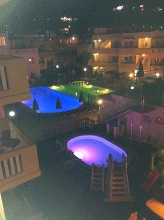 Menia Beach Hotel: pools by Night