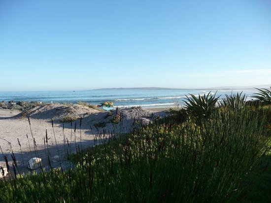 Zula Beach House and Cottage : View when standing outside the wood gate