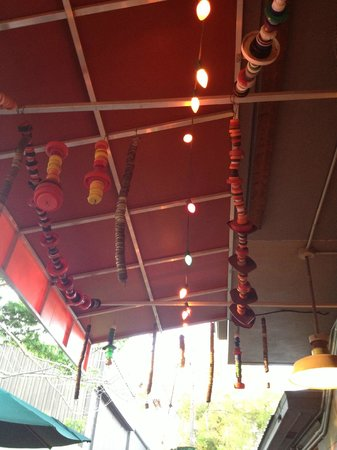 Satchel's Pizza: Hanging above our outdoor table.