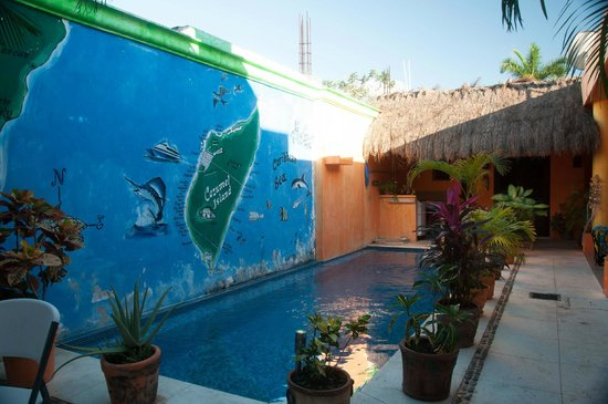 Casita de Maya: mural and pool in center of hotel