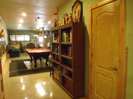 Kettle Creek Adventures Lodge and B&B: view from hall to pool table