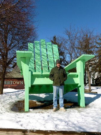 Large Green Chair: 6 foot husband looks tiny next to the chair