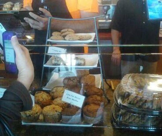 Offerdahl's: taking order over the baked goods with no covering.. talking over them and all ..yuk