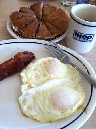 IHOP: eggs over med, crisp bacon, harvest grain n but cakes.