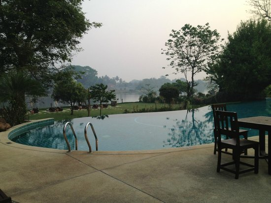 The Legend Chiang Rai: The pool for all guests, empty early in the morning