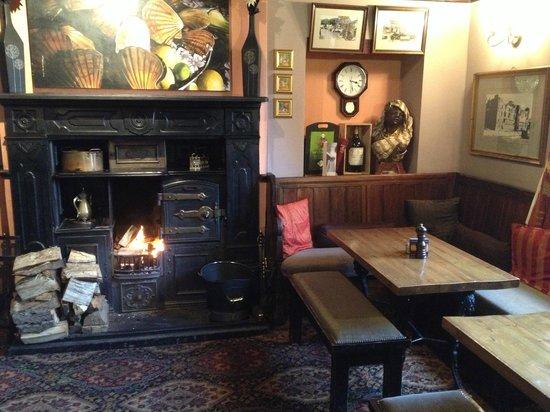 The Old Hall Inn: Log fire in the main bar