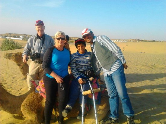 Desert Safariors Camps : Guest enjoying camel ride at dunes