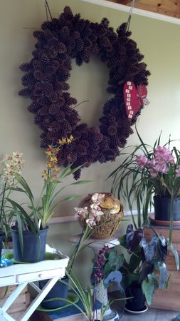 Garden Cafe at McLane's Country Garden: dining room orchids and wreath
