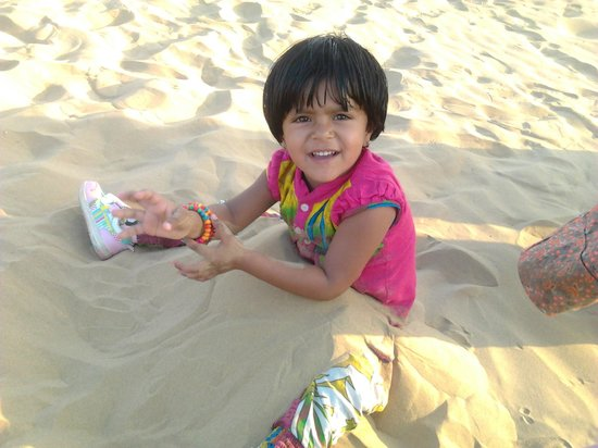 Desert Safariors Camps : Kid playing wid sand