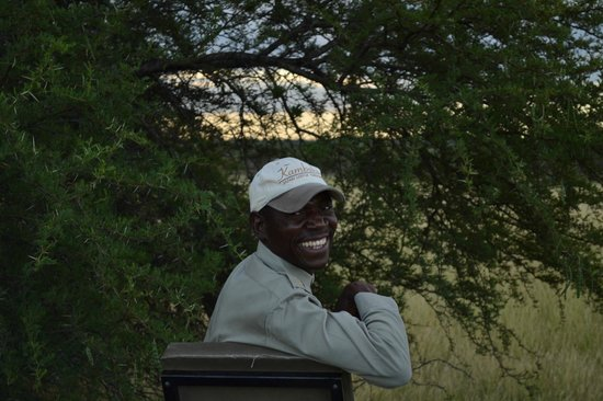 Kambaku Safari Lodge: our tracker Eric! so excited about our cheetah sighting