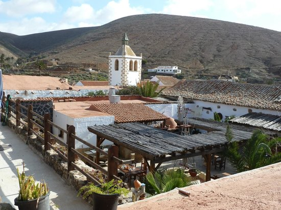 Casa Princess Arminda: View over the Princess Arminda, showing open courtyard from above, Church in background