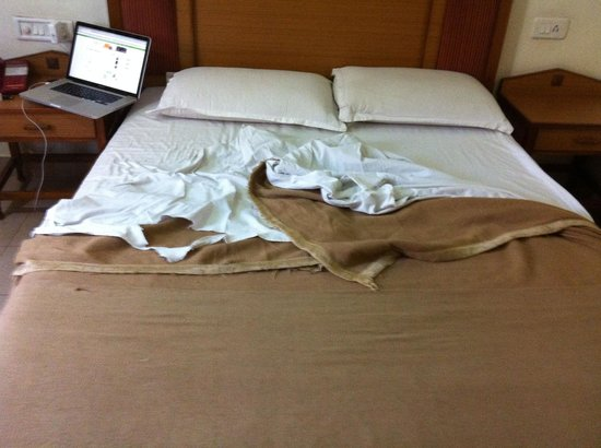 Rukmini Riviera Hotel: Torn Bedsheets and Blankets