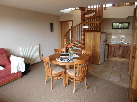 Lonsdale Views: Living and kitchen area, plus THAT SPIRAL STAIRCASE.