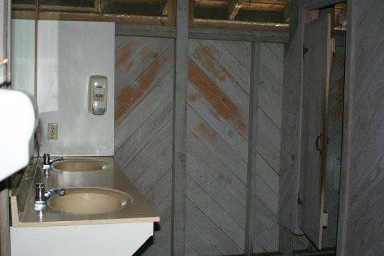 Cumberland Island National Seashore: Women's Bathroom (two sinks, soap dispenser, outlet, three stalls)