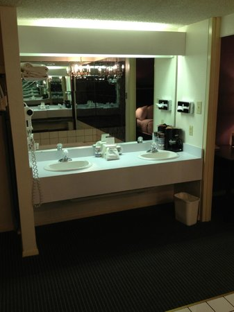 Stevens Inn: Open concept bathroom area -- tub area visible in mirror