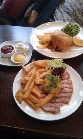 The Folly Inn: Grilled Gammon with crispy poached egg and chips.  Cod fillet with crushed peas and chips