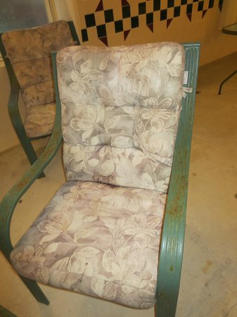 Comfort Inn & Suites : Outdoor lawn furniture in indoor pool area - very rusted and cushions were moldy