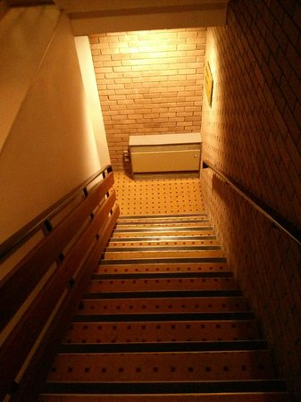Hilton Bracknell: A 1990s stairwell - concrete, drab, dull, cold and with an antiquated heater!