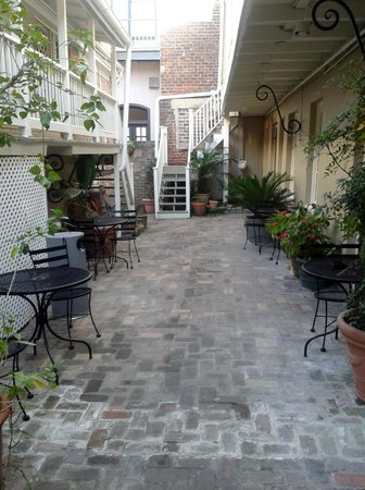 Inn on Ursulines: courtyard with steps leading up to the upper rooms