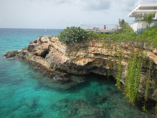 Four Seasons Resort and Residences Anguilla: View of the cave we snorkeled in and Coba restaurant on the right