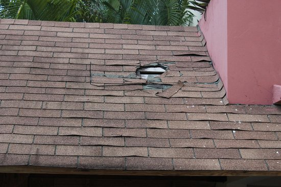 Dreams Punta Cana Resort & Spa: Hole in the roof, hallway to Building #2