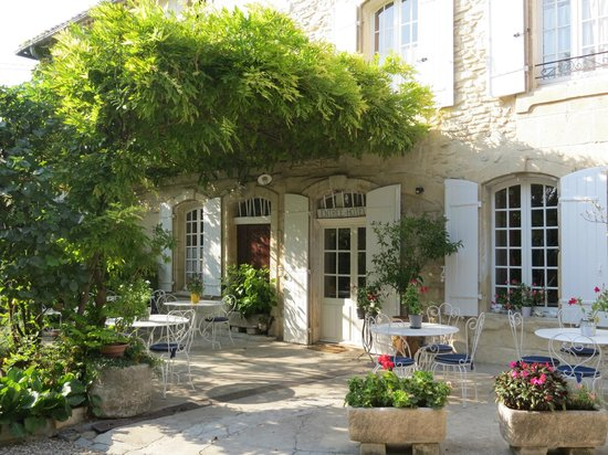 Le Cadran Solaire : The entrance, dining porch, and perfect place to enjoy a bottle