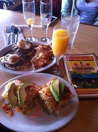 Canoe House: tsunami breakfast burrito, pork hash with poached eggs and Mimosas