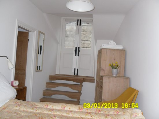 double doors leading onto balcony in main bedroom