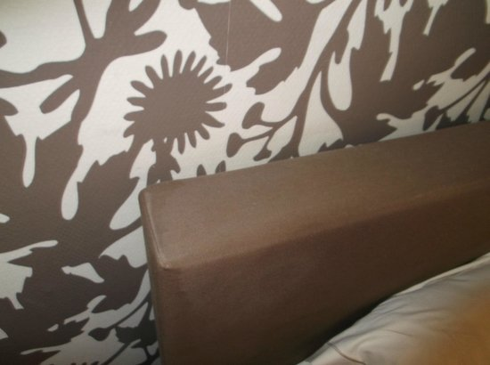 Central: Dusty headboard.