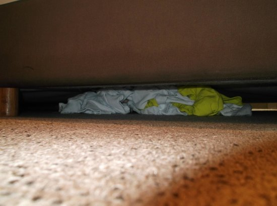 Central: A former guests clothes under the bed.