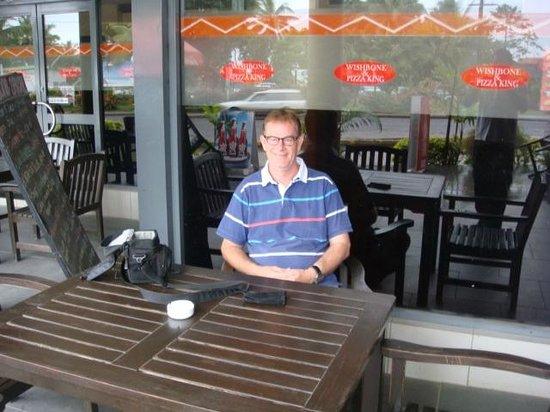 Pizza King/Wishbone Chicken: relaxing outside restaurant