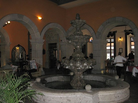 Hotel Morales Historical & Colonial Downtown Core: Hotel Morales lobby atrium and dining area with fountain