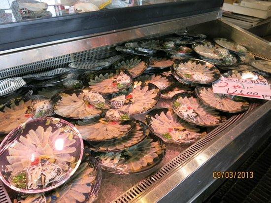 Shimonoseki Fish Market: Fugu Sashimi to go! Everywhere and very cheap and good.