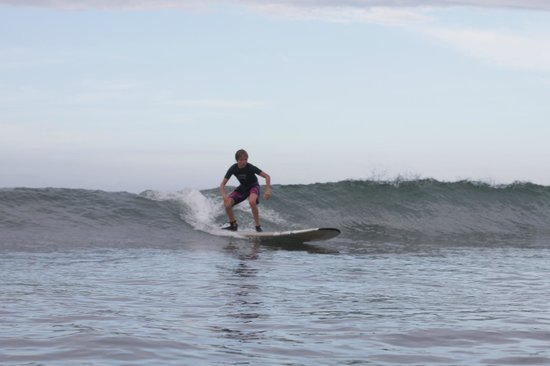 Waves Hawaii Surf School: Isaac catching some great waves!!