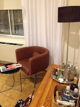 NU Hotel: mini-bar and seating area. simple; clean