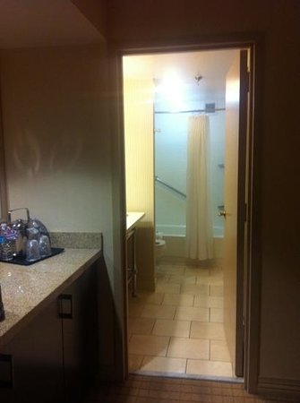 Sheraton Suites Market Center: walking into the bathroom ... coffee maker and counter to the left