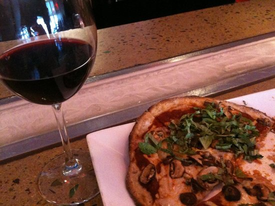 Pizza Fusion: Vegan with soy cheese on multigran crust and kalamata+fresh basil topping!