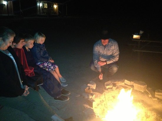 Hualapai Ranch: Campfire with cowboy at night. Making smores and telling ghost stories.