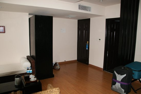 Anise Hotel : seating area, entrances to room and bathroom with good sized wardrobe and safe