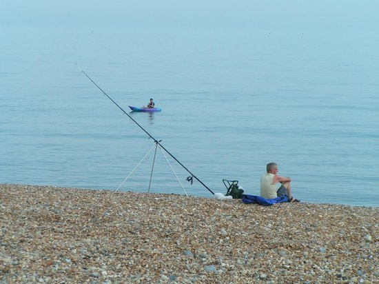 Pevensey Bay Beach: Fishing and boating on a very calm sea