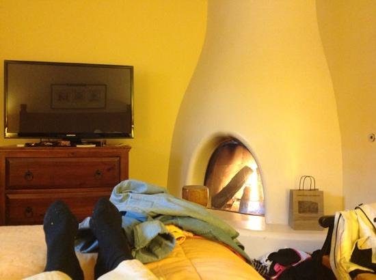 Old Santa Fe Inn: View of fireplace from the king bed.  Ahhh.