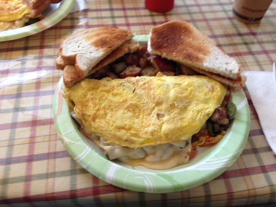 Robie's Country Store: A Veggie Omelet, Swiss Cheese, an add of sausage, and Rye Toast