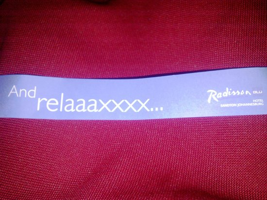 Radisson Blu Hotel Sandton, Johannesburg: Tag on bathrobe