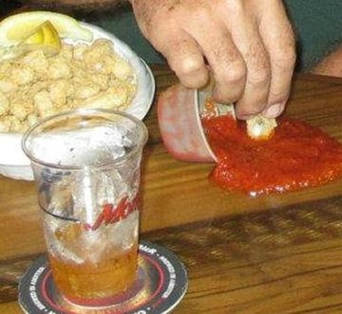 Monty's Raw Bar and Restaurant: Oops...but too good to waste, while the waiter gets more!