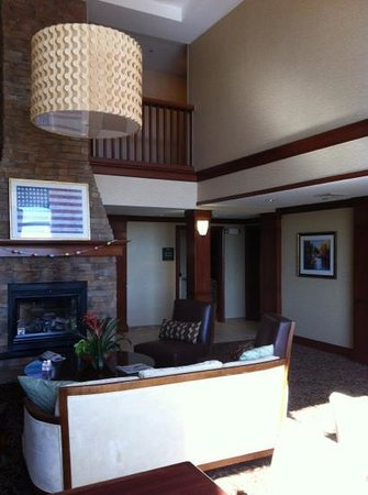 Homewood Suites by Hilton Stratford: fireplace with comfortable chairs
