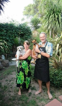 Seas The Day B&B: Our fabulous hosts generously posing for us with their pups at Seas the Day