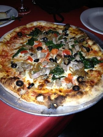 Fat Clemenza's: wood fired Italian sausage pizza with black olives and tomatoes.