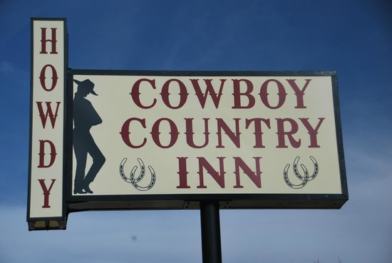 Cowboy Country Inn sign on the corner