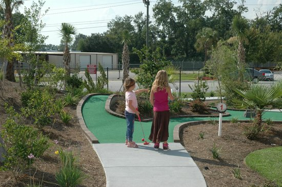 Jungle Jym's Family Fun Center: Playing putt putt. There are no shady areas so I do not recommend taking kids in the summer!