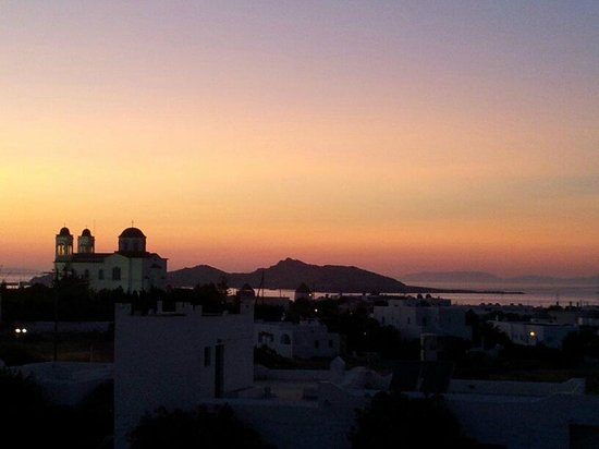 Kallisti Rooms & Apartments: View from our balcony over Naoussa at sunset